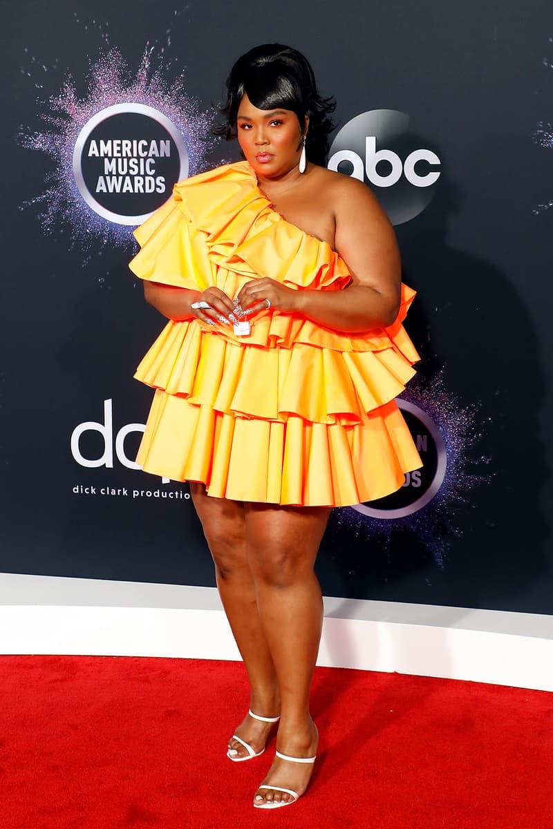 american music awards amas best celebrity red carpet looks lizzo valentino orange dress tiny bag heels