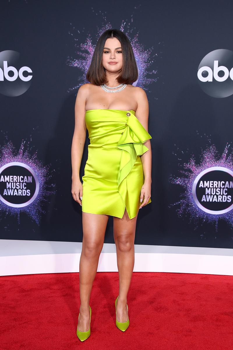 american music awards amas best celebrity red carpet looks selena gomez neon green dress heels