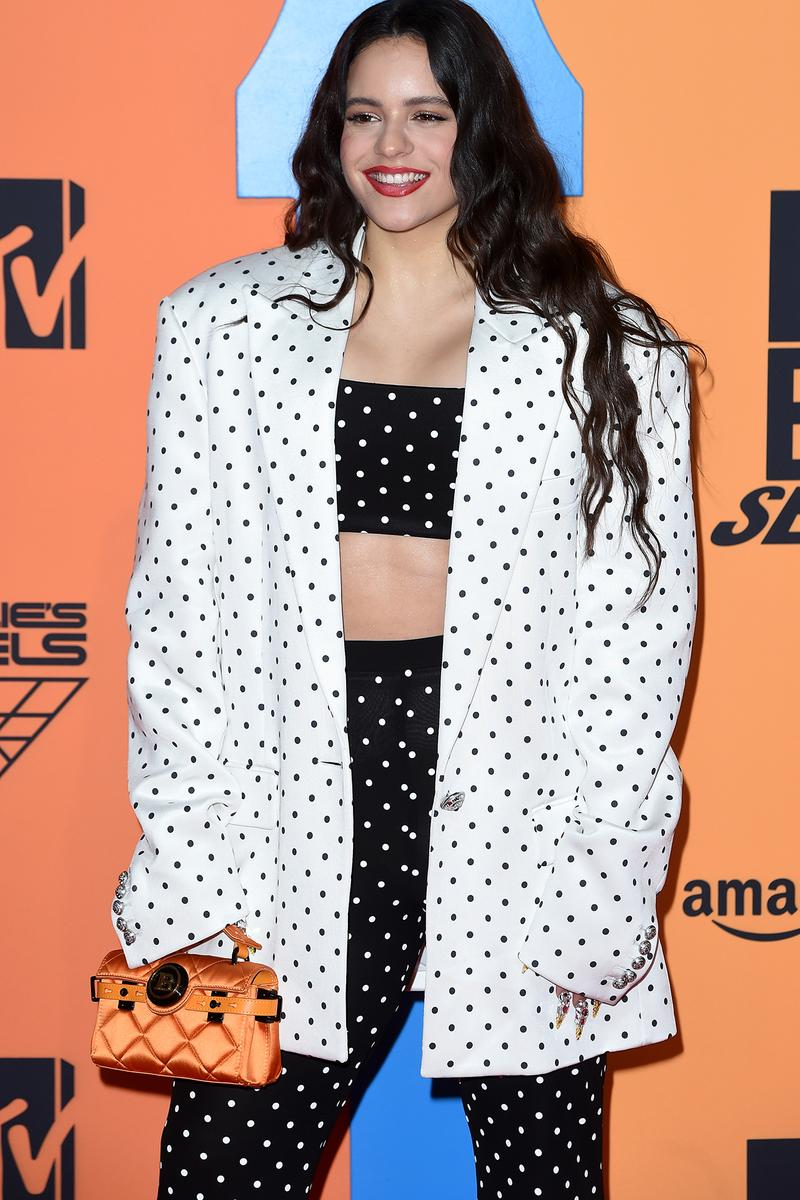 Rosalia Singer Music Artist MTV EMAs 2019 Red Carpet Suit Bra Top Orange Balmain Bag
