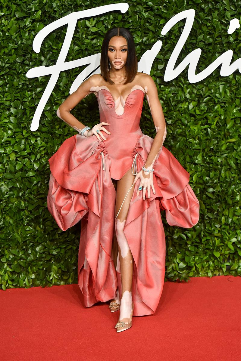 british fashion awards bfas best celebrity red carpet looks winnie harlow red orange gown model
