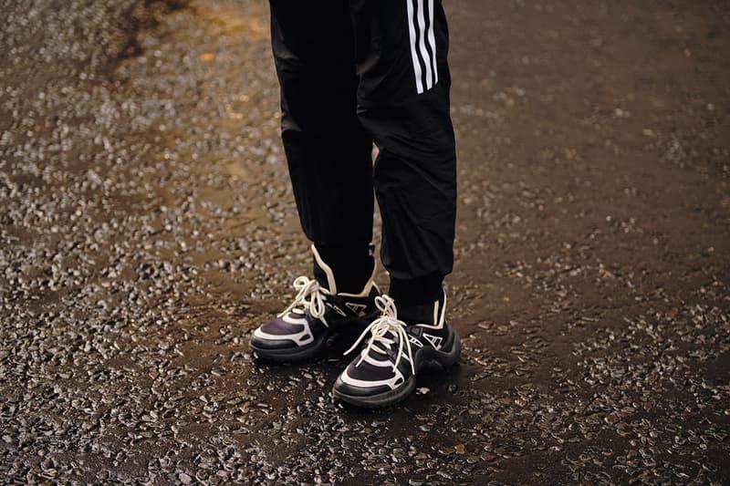 Street Style London Fashion Week Fall Winter 2020 louis vuitton archlight sneaker adidas trackpants