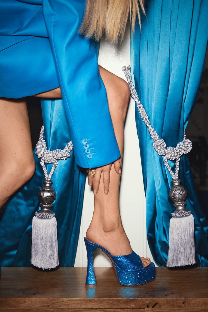 Mytheresa x Amina Muaddi Capsule Collection Bianca Mule Glitter Blue