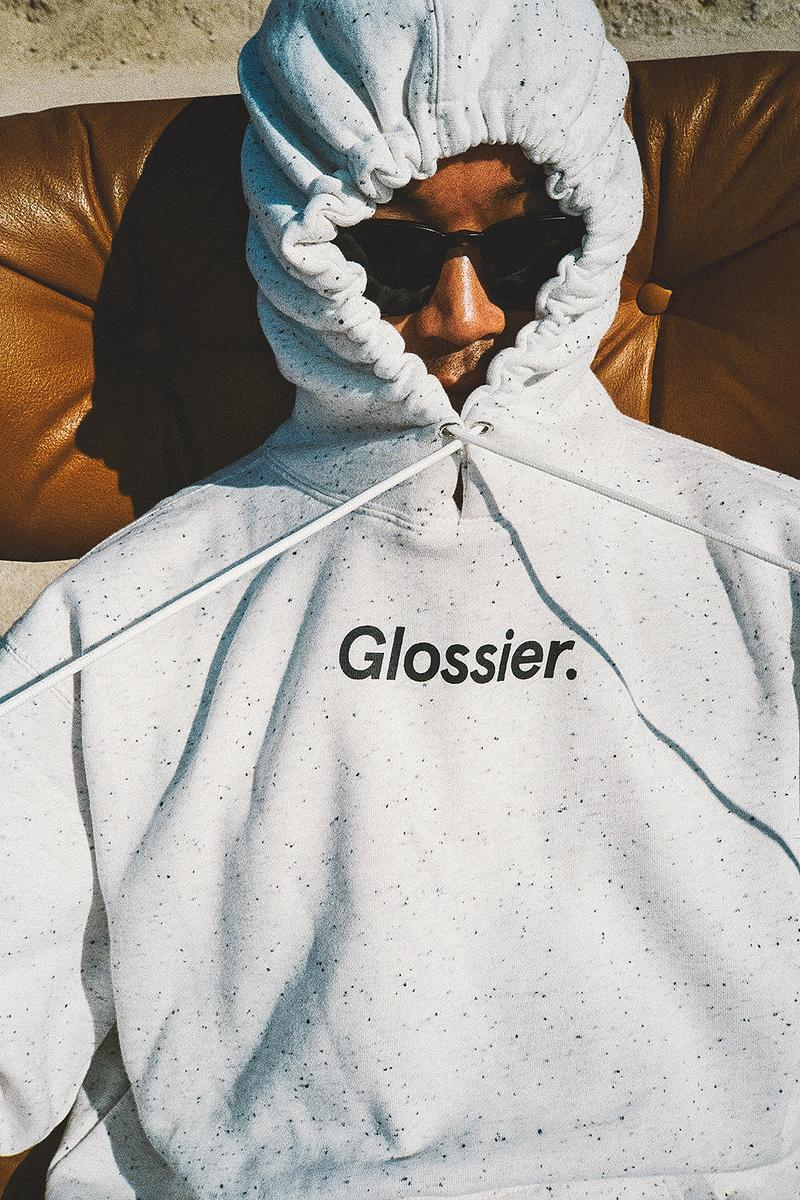 glossier glossiwear limited edition terrazzo hoodie gray sneaker white duffle bag