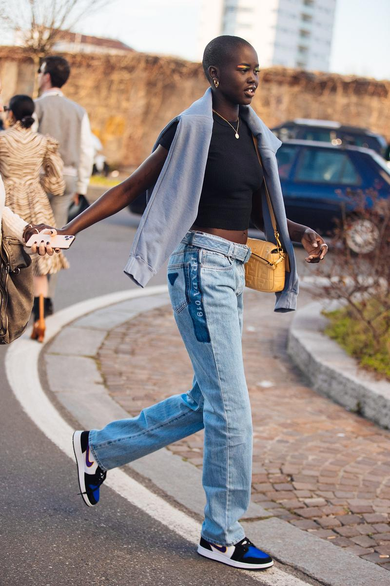 Adut Akech South Sudanese Model Supermodel Off Duty Fashion Week Outfit Fendi Bag Baggy Jeans Blue Outfit Nike Sneakers