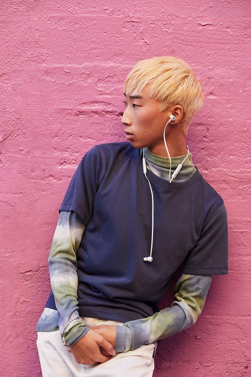 beats flex new colors smoke gray wireless earphones headphones listening music pink wall