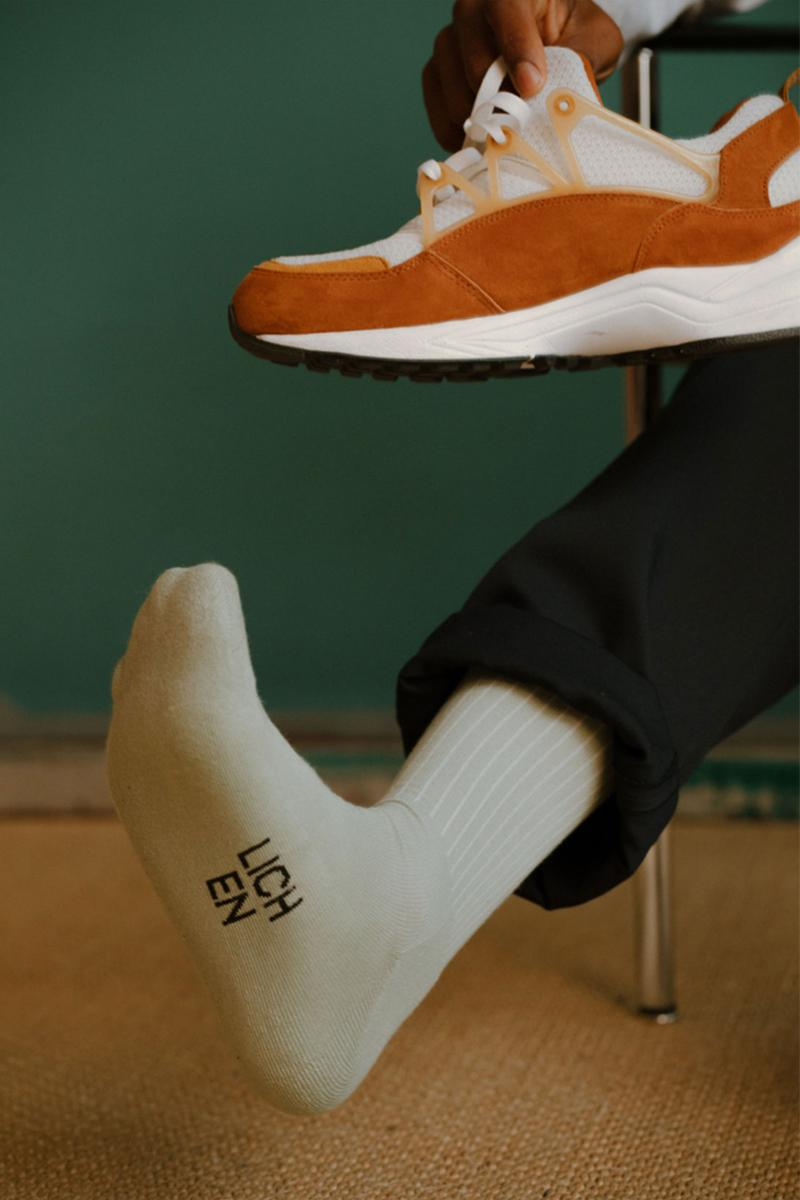 comme si lichen collaboration lookbook logo socks green sneakers
