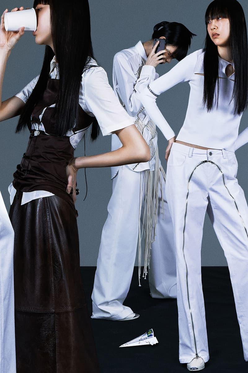 korean fashion emerging female designers brands nibgnus white jeans zipper details black vest