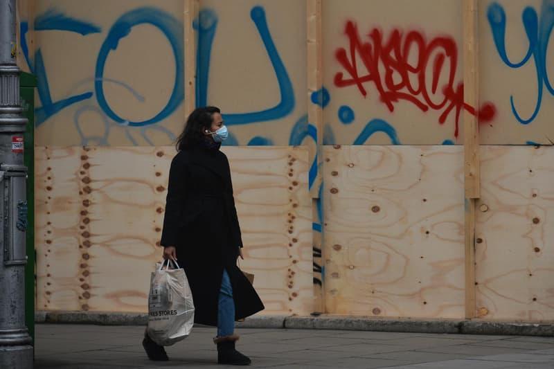 Woman Face Mask Closed Store Dublin Ireland Coronavirus COVID-19 Lockdown