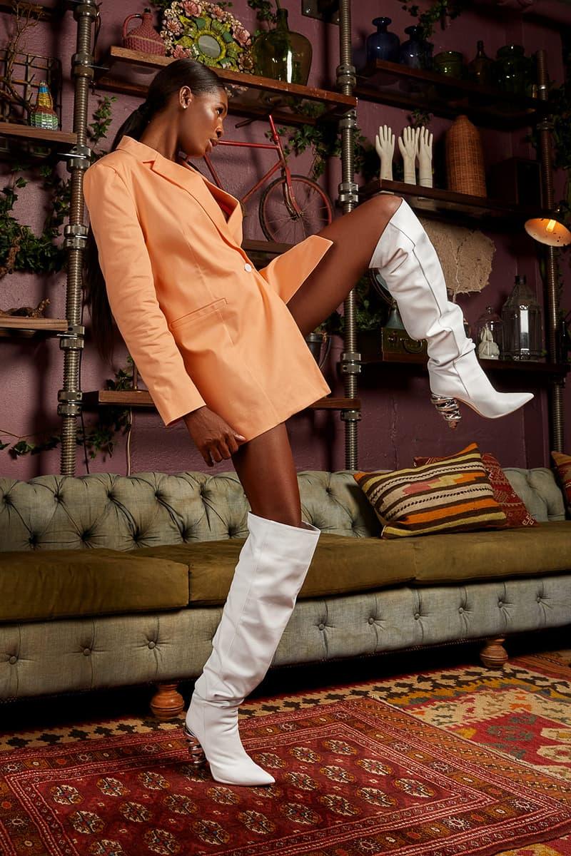 keeyahri zerina akers shoes collaboration thigh high boots white carpet rug orange blazer jacket sofa