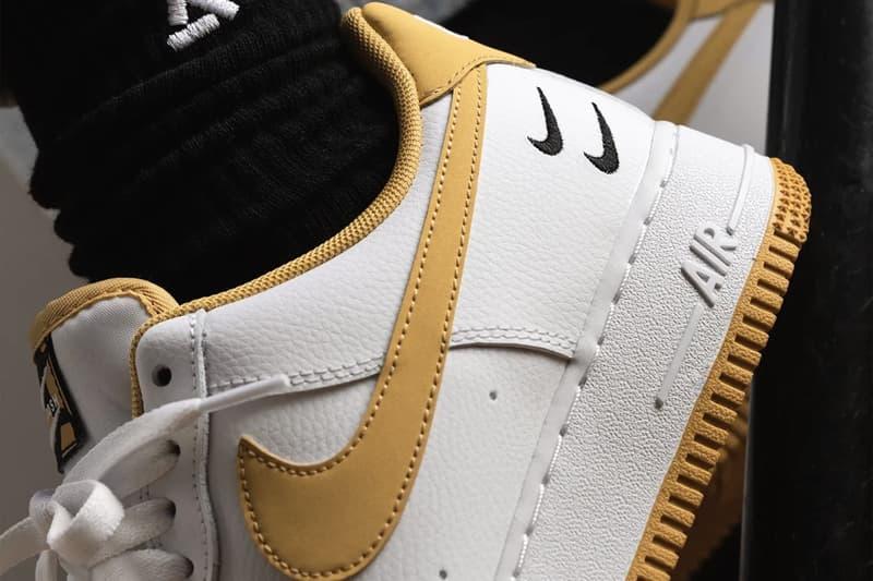 nike air force 1 af1 sneakers light ginger mustard yellow white black colorway footwear sneakerhead shoes close up shot heel