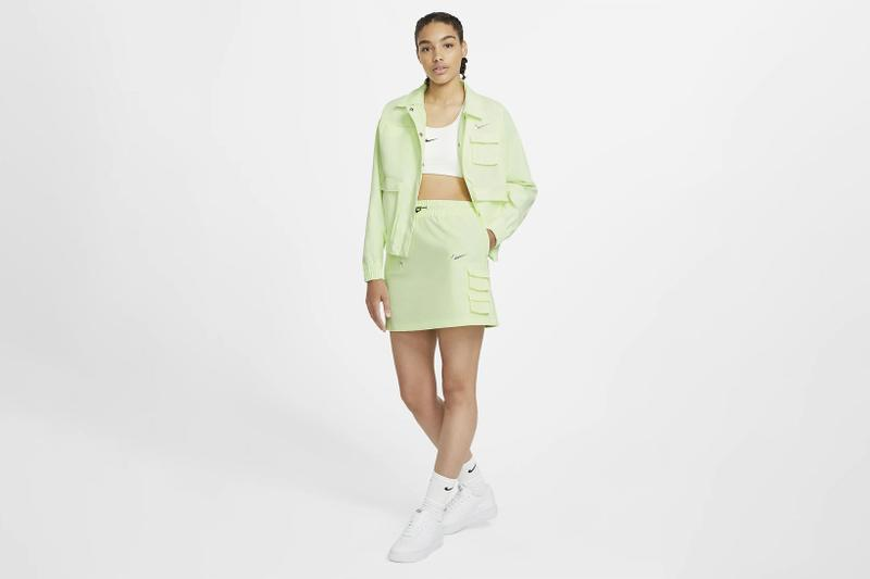 nike sportswear swoosh logo skirt barely volt spring summer outfit green jacket white cropped top sneakers