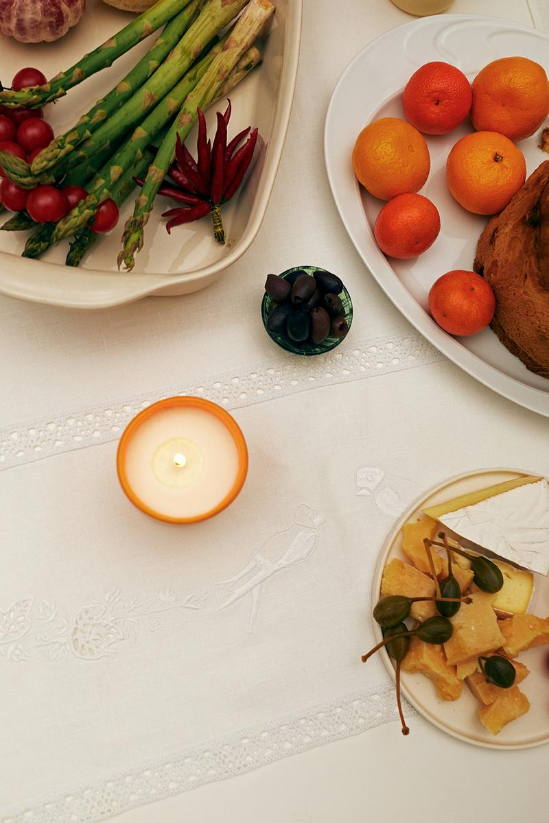 sleeper home homeware decor collection candle plates asparagus food fruits orange table cloth white