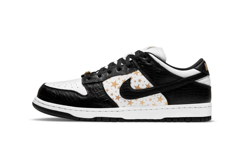 supreme nike sb dunk low collaboration sneakers black white colorway lateral gold stars laces