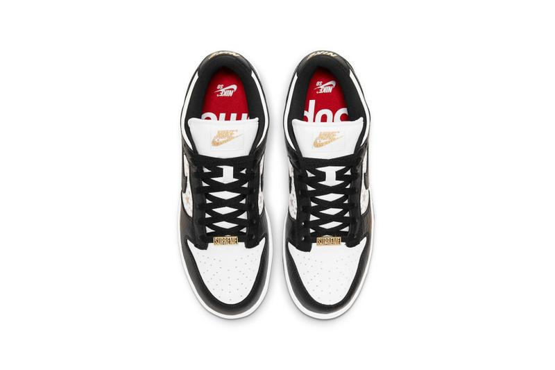 supreme nike sb dunk low collaboration sneakers black white colorway gold stars laces red insole