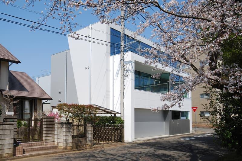 japan aisaka architects atelier house in tsukuba exterior cherry blossoms