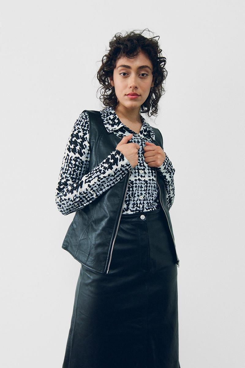 stussy spring 2021 collection lookbook womenswear black and white shirt leather vest skirt