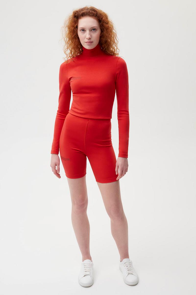 pangaia roica stretch athleisure sustainable collection turtleneck top bike shorts red