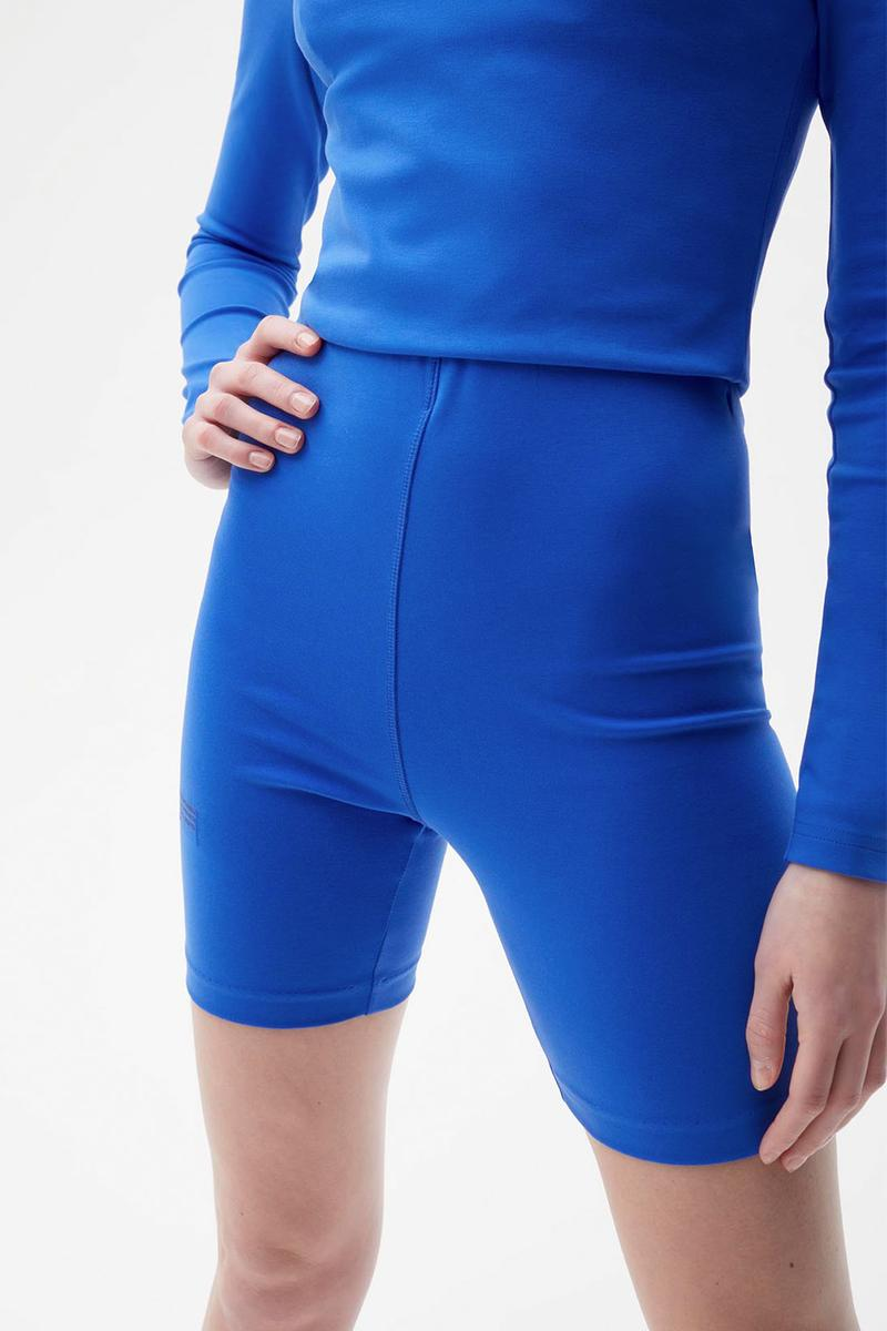pangaia roica stretch athleisure sustainable collection turtleneck top bike shorts blue