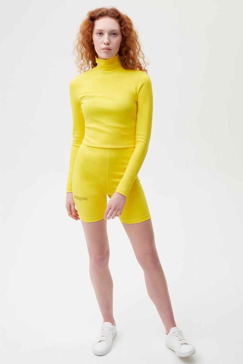 pangaia roica stretch athleisure sustainable collection turtleneck top bike shorts yellow