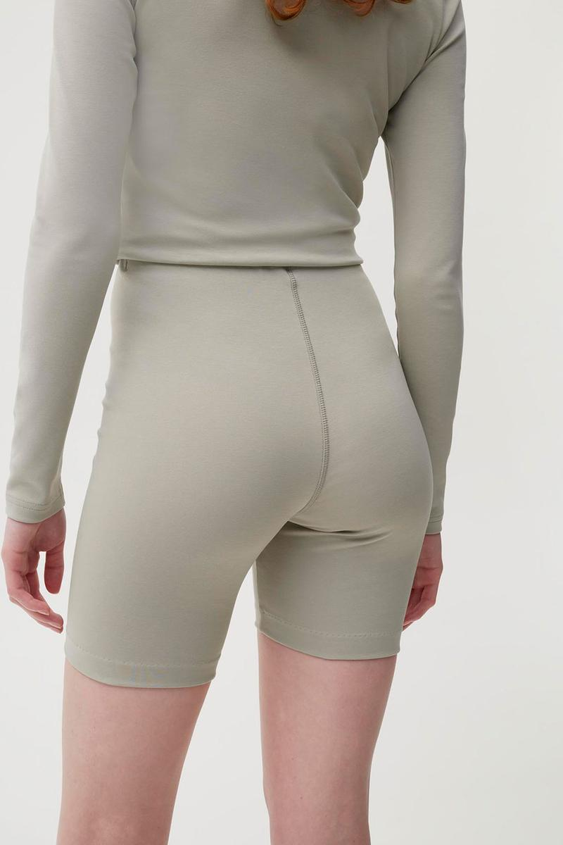 pangaia roica stretch athleisure sustainable collection turtleneck top bike shorts gray beige