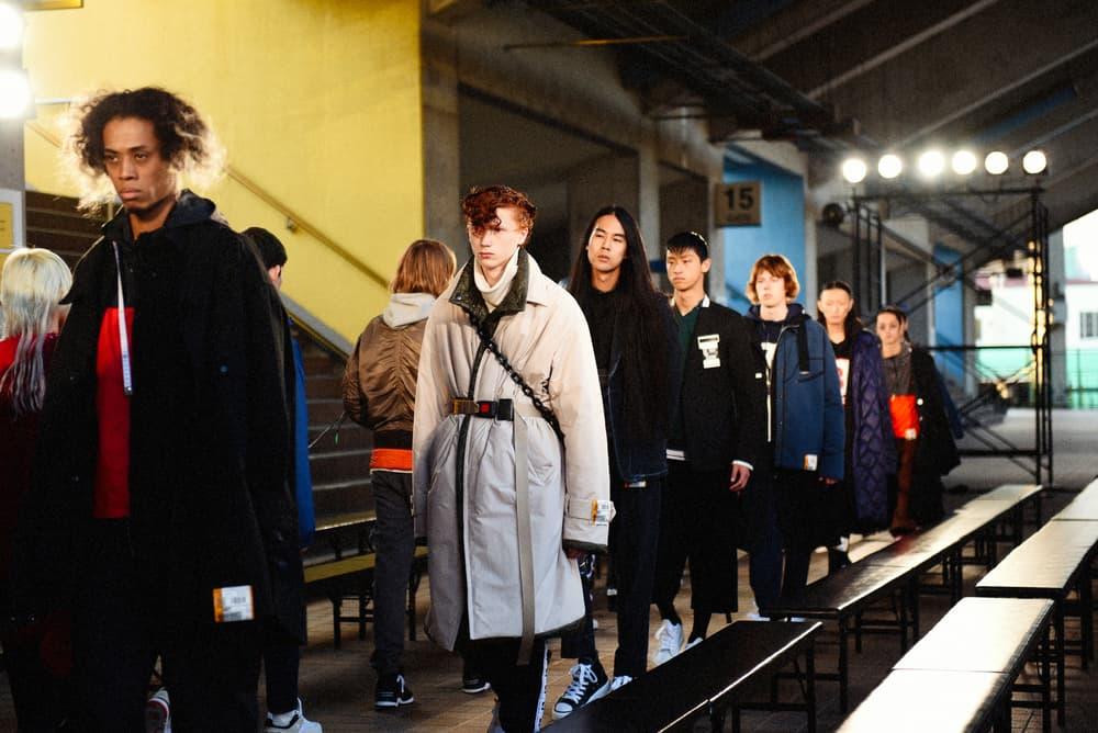 """破天荒な演出で観客を虜にした Maison Mihara Yasuhiro 2018年秋冬ランウェイショーにクローズアップ 〈DC Shoes〉とのコラボスニーカー誕生秘話や今後の展望に迫る三原康裕の独占インタビューも敢行 Amazon Fashion Week TOKYO 2018 A/W 3月28日(水) パリ ミラノ ロンドン Maison Mihara Yasuhiro メゾン ミハラヤスヒロ ブランド創設20周年 秩父宮ラグビー場 ランウェイショー 三原康裕 Sosu ソスウ CEO 陵本望援 Proto-Type プロトタイプ 高橋ラムダ MMY SOIL & """"PIMP"""" SESSIONS ソイル アンド ピンプセッションズ Kick a Show キッカショウ IVAN アイヴァン 中野皓 41名 モデル テーラードジャケット デニムジャケット 真壁刀義 鎖付きのモッズコート DC Shoes DCシューズ HYPEBEAST ハイプビースト"""