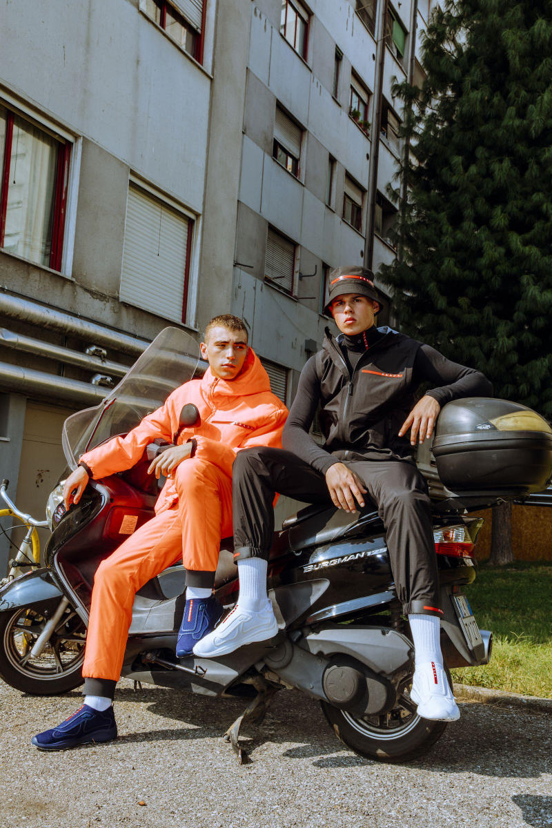 Prada Sports nss magazine linea rossa editorial fall winter 2018 sneakers white blue orange black tracksuit hoodie pants turtleneck logo
